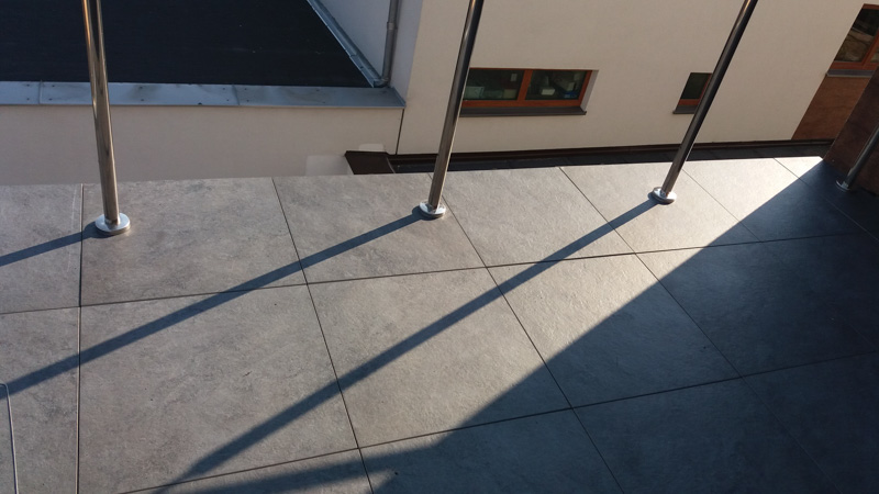 balcony balustrade on the ceramic patio tiles of the ventilated terrace