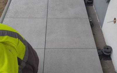 Adjustable pedestal installation on construction site