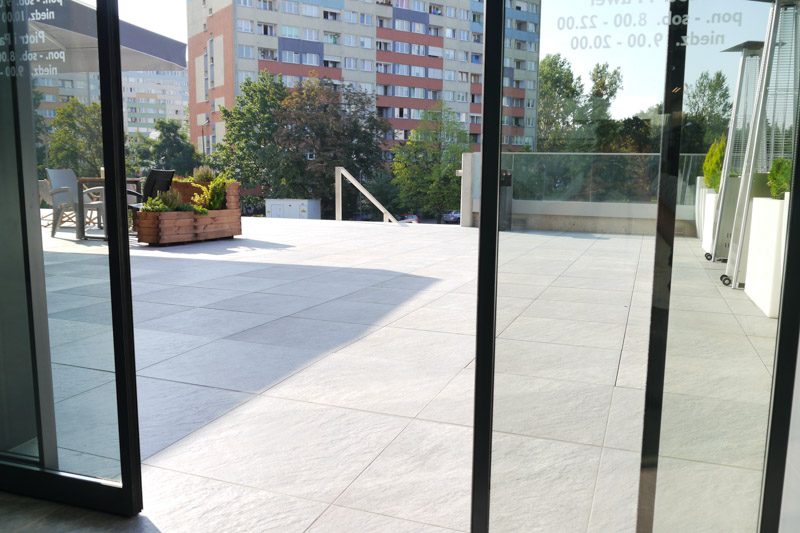 Ventilated terrace from ceramic patio tiles by the office