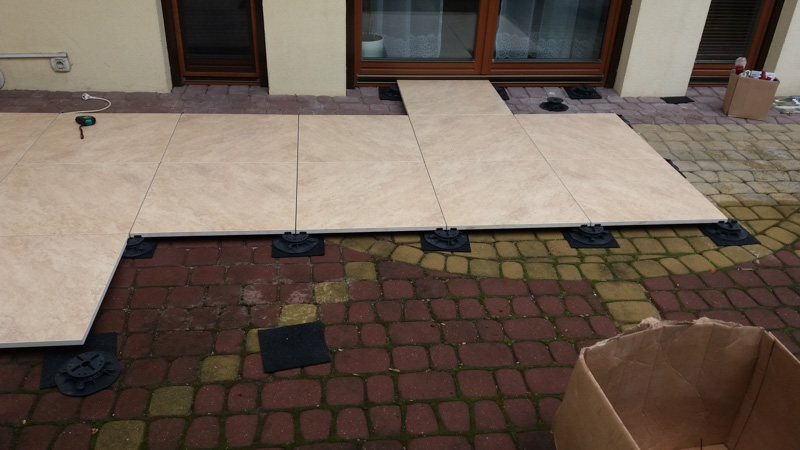ventilated terrace made by ceramic patio tiles for the terrace on old paving