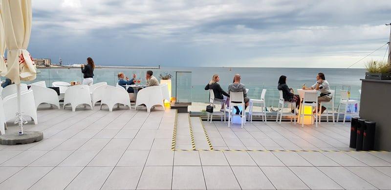 Restaurant patio raised on adjustable pedestals