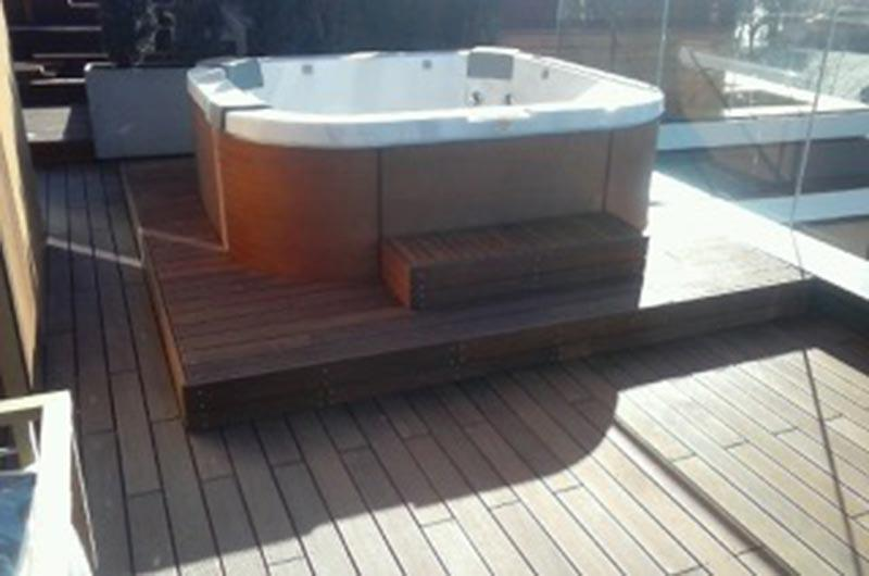 Jacuzzi on the wooden terrace with adjustable deck pedestals