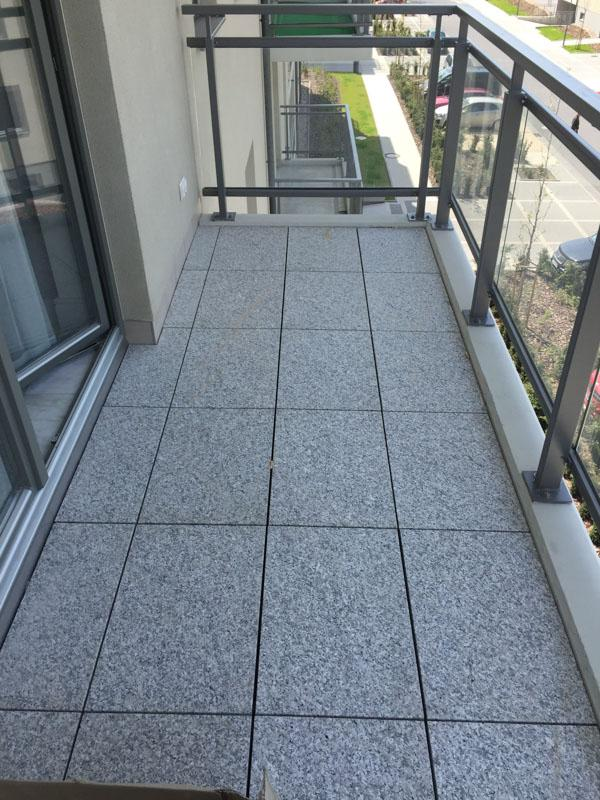 terrace adjustable pedestals under stone terrace tiles on balcony