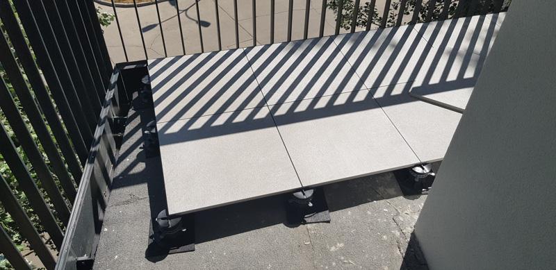 ceramic tiles on adjustable pedestals and rubber shim