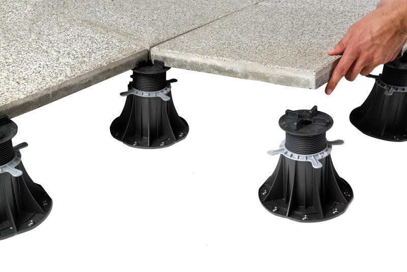 concrete tiles laid on plastic adjustable pedestals for terrace tiles