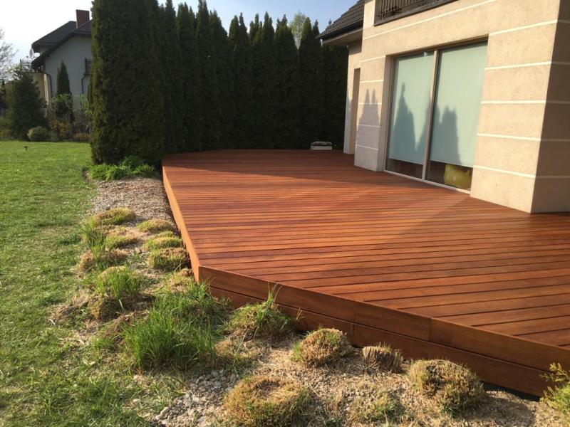 wooden terrace in the garden from exotic wood on adjustable pedestals