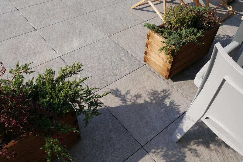 ventilated terrace from stone tiles on adjustable pedestals
