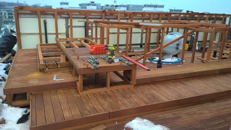 wooden structure of the seats around the pool on adjustable deck pedestals system