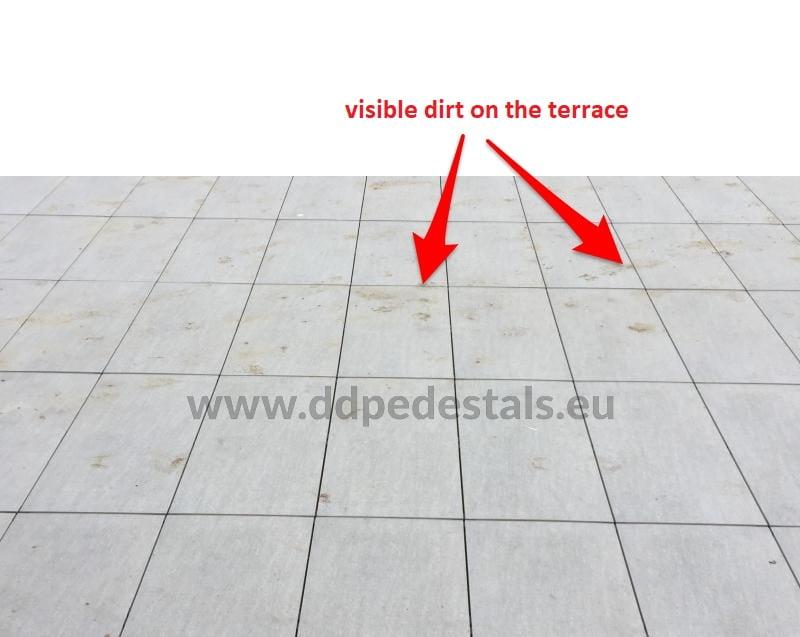 dirt on the raised terrace on adjustable pedestals