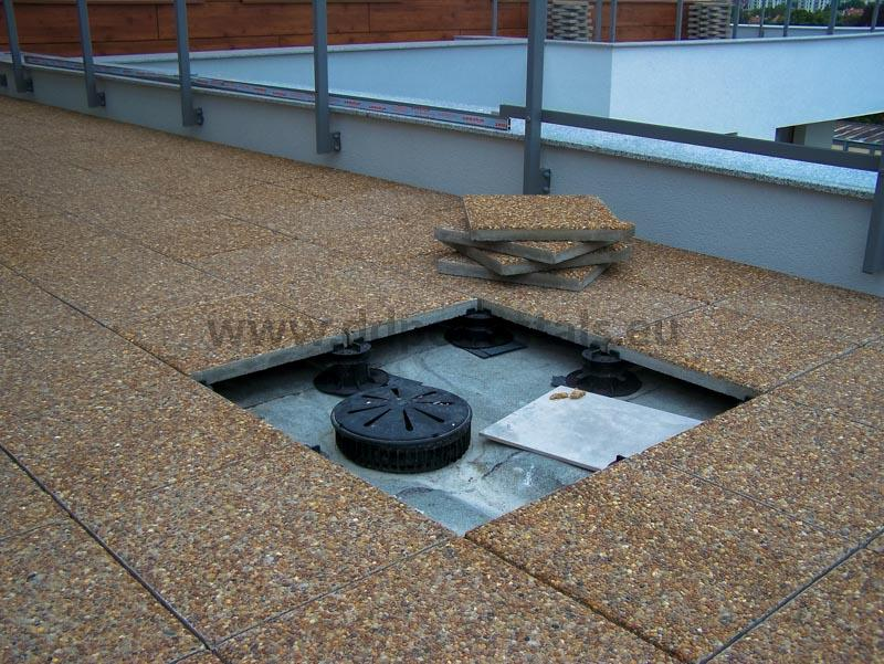 tiles laying on adjustable paving slab supports DD Pedestals