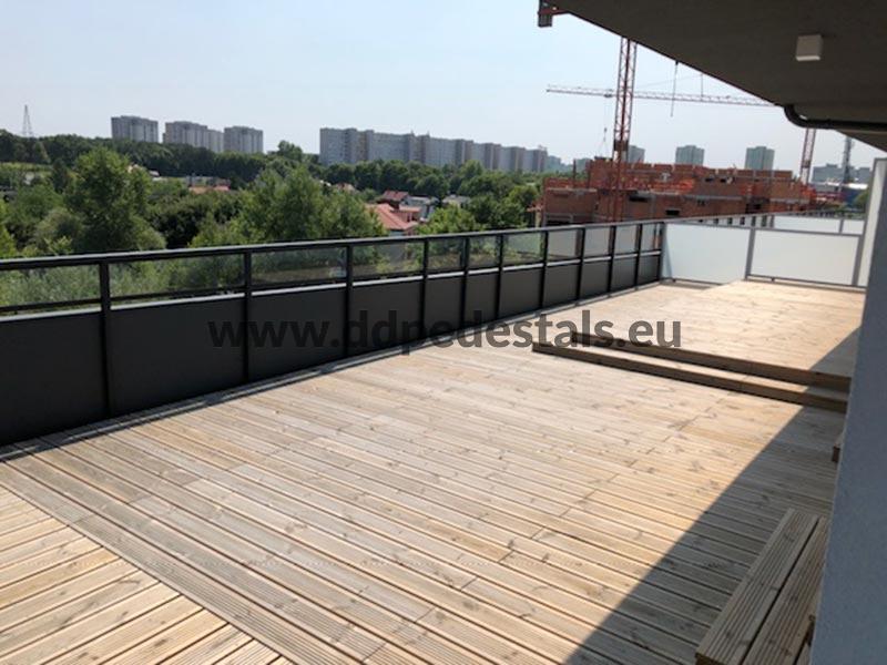 raised, ventilated terrace on adjustable pedestals- summer