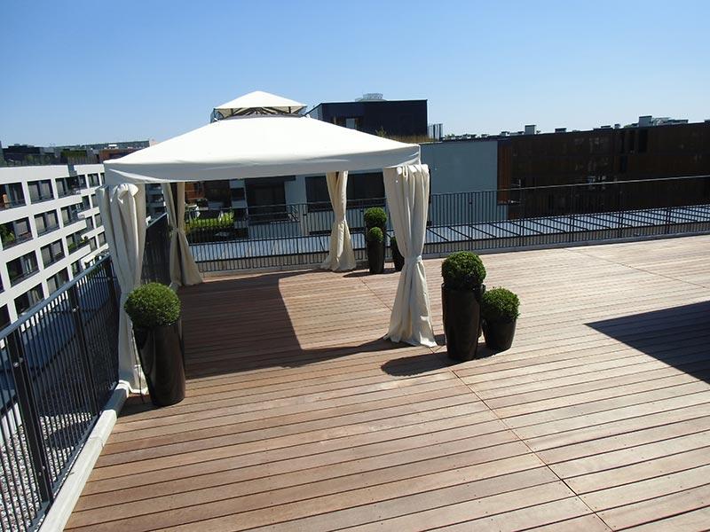 tent, pergola set on awooden terrace on adjustable pedestals