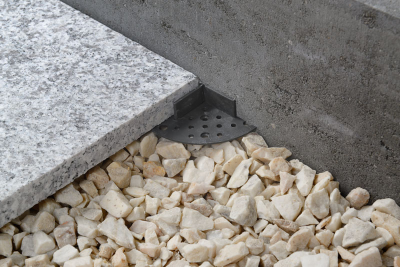balck support pads near the wall