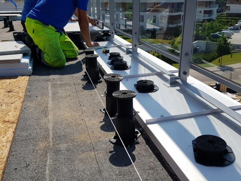 montage terrace tiles on adjustable pedestals