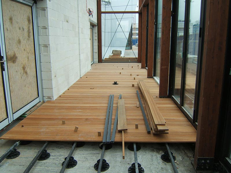 deck of boards on adjustable pedestals