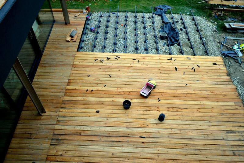 ventilated terrace made of wooden boards on the ground