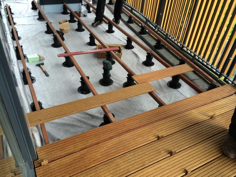 wooden joists as a substructure of a ventilated terrace made of wooden boards