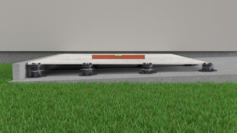 slope on the ground leveled with adjustable pedestals with self-leveling heads
