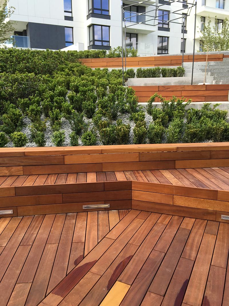 ventilated wooden terraces on the patio between the blocks of flats