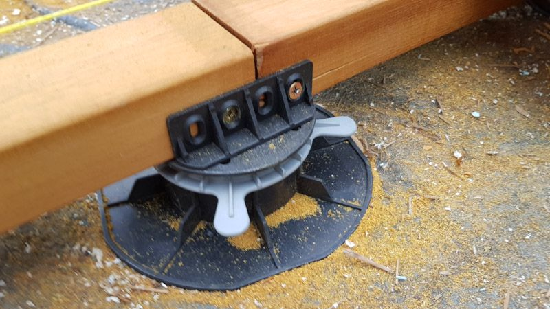 joist mounted to the adjustable pedestal by an adapter